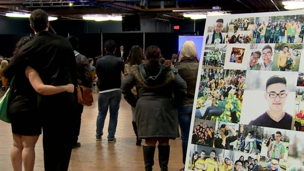 Dozens of people attend a memorial service for Evan Tran, 21, a university student who took his life on campus over Thanksgiving weekend. His family publicized his death to  raise awareness about mental health.