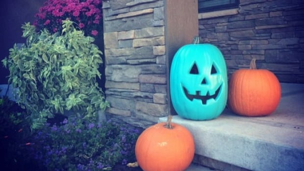 By painting a pumpkin teal, and you'll be letting trick-or-treaters with food allergies know that you're also handing out non-food items this Halloween.
