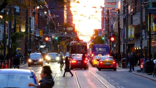 "The sun set perfectly in line with Toronto's east-west streets on Monday, creating a phenomenon dubbed ""Torontohenge."""