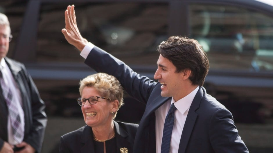 Canadian prime minister-designate Justin Trudeau is greeted by Ontario Premier Kathleen Wynne at the Queens Park Legislature in Toronto on Tuesday.