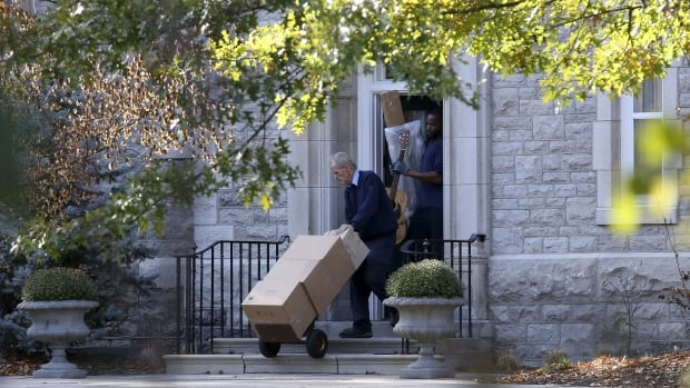 Movers carry items from 24 Sussex, the official residence of Canada's prime minister, in Ottawa on Tuesday.