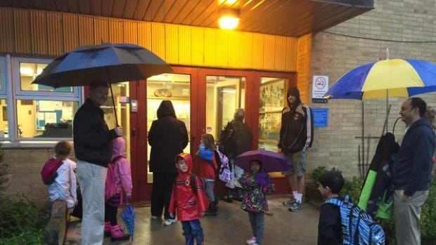 Students at Yorkview Elementary were locked out in the rain Wednesday morning. A parent said it was a casualty of work-to-rule action brought on by labour negotiation, but the district said the door situation was not directly connected to the job action.