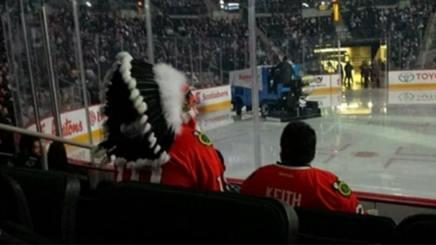 A fan wears a headdress at the Jets and Blackhawks game in March at Winnipeg's MTS Centre. True North Sports and Entertainment has decided not to ban headdresses from future sporting events at the Winnipeg arena.