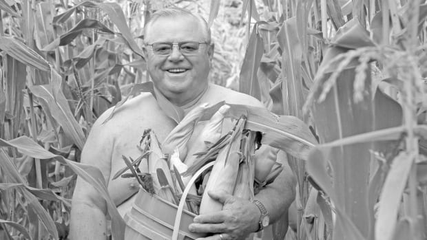 Doug Collins, 68, posed in his corn field for the calendar. Collins, who is retired, sits on the town's municipal council and sells his sweet corn at roadside stands.