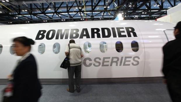 epa02927599 Visitors pass by a section of a Bombardier plane on display during the Aviation Expo China 2011 at the National Convention center in Beijing, China on 21 September 2011. China is expected to become the second largest aviation market after the United States by 2030 with Chinese aircraft manufacturers joining the top four, said Airbus Chief Operating Officer Customers John Leahy, state media Xinhua reported on 20 September.  EPA/HOW HWEE YOUNG