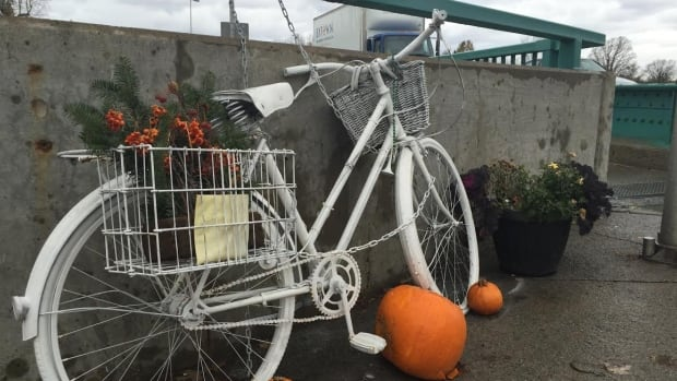 A ghost bike sits at the corner of Bank St. and Riverside Dr., where cyclist Meg Dussault was hit and killed by a cement truck in July 2013.