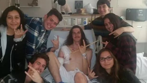 Jack Thomas with friends, who started an online fundraiser for him after he lost his arm in a work-related accident.