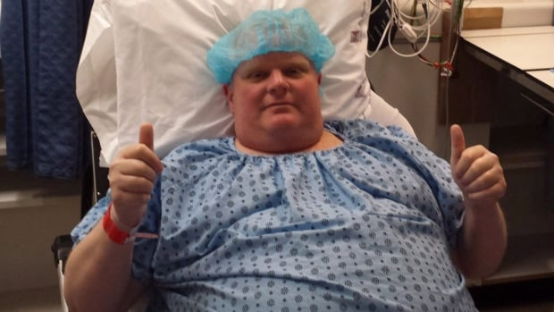 Ford gestures two thumbs up before surgery to remove a cancerous tumour from his abdomen in Toronto on May 11, 2015.