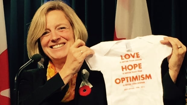 Premier Rachel Notley says pregnant MLA Stephanie McLean will be given this onesie bearing the words of the late Jack Layton.