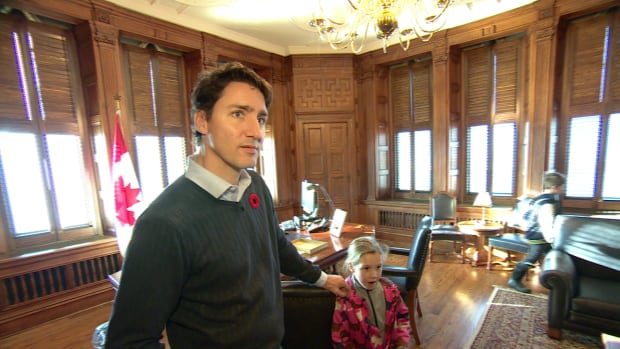 Prime Minister Justin Trudeau shows his children his new office on Parliament Hill in 2015. A new report indicates the cost of running the Prime Minister's Office rose to $8.3 million in 2016-17.