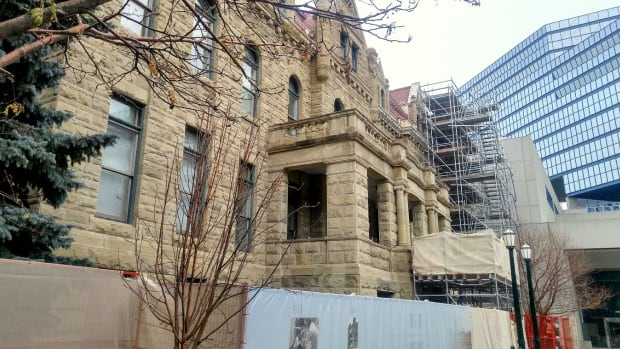 Protective scaffolding was put around Calgary's Old City Hall in 2014 to prevent falling pieces of sandstone from hitting pedestrians.