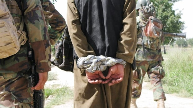 An Afghan suspect is interrogated during a joint Canadian-Afghan army patrol in the Panjwaii district of Kandahar province in 2009. Canada's treatment of detainees will be probed once again by the Military Police Complaints Commission after an anonymous tip was received by the watchdog.