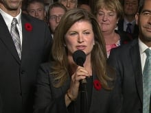 Rona Ambrose smiles as she is introduced as the interim-leader of the Conservative party following a caucus meeting Thursday November 5, 2015 in Ottawa.
