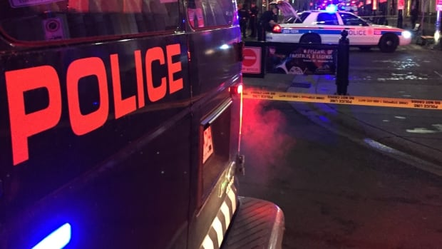 Calgary police investigate after a two people were shot on Stephen Avenue in November.
