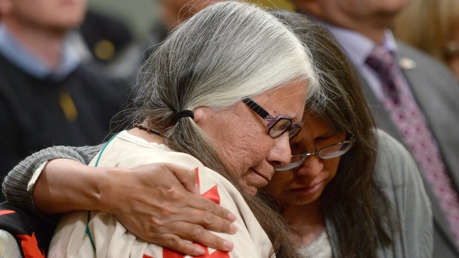 Residential school survivor Lorna Standingready is comforted by a fellow survivor in the audience during the closing ceremony of the Indian Residential Schools Truth and Reconciliation Commission, at Rideau Hall, June 3, 2015.