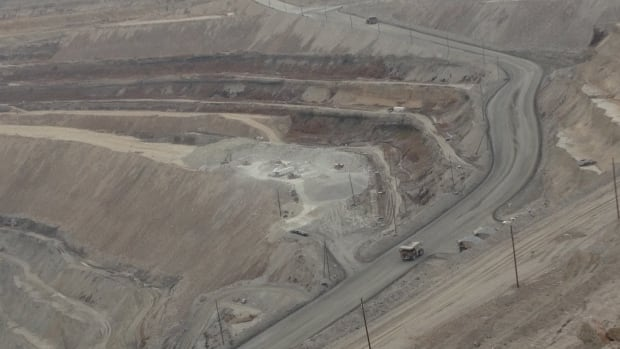 Haul trucks loading from the bottom of the valley pit at Highland Valley Copper in Nov. 2015.