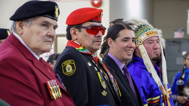 Richard Blackwolf, far left, says the Canadian Armed Forces members who confronted Indigenous activists were 'silly' to have gotten involved in a standoff, but should not be forced out of the military.