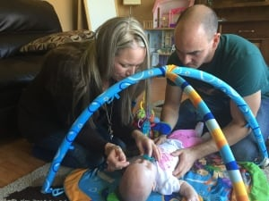 family plays with baby