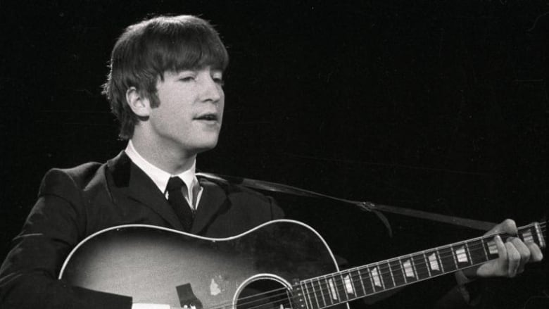 John Lennon S Acoustic Guitar Sells For 2 4m At Auction Cbc News