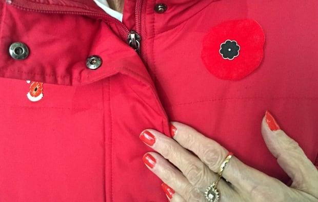 Poppy pin on jacket
