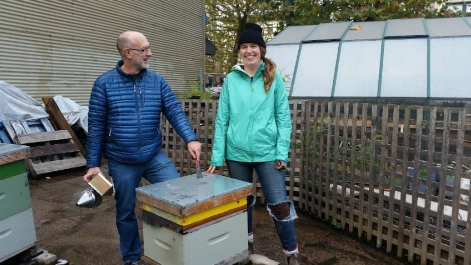 """""""Bee Time"""" author Mark Winston and Sarah Common with Hives for Humanity. Mark Winston says we need to pay attention to the plight of bees because he believes bees have a lot to teach us about how we interact and how to be present in the world."""