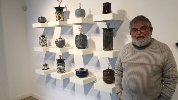 Jack Sures shows off his pottery at the Slate Fine Art Gallery.