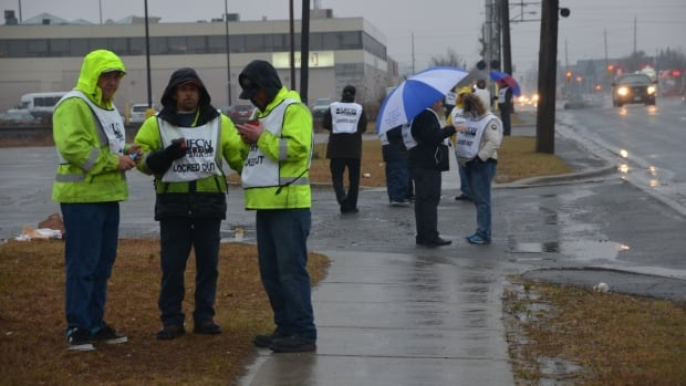 Fourteen workers at Rona in Sudbury began a picket line in the rain on Thursday after being locked out by their employer.