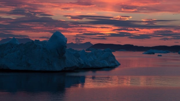 The setting sun paints a dramatic sky over icebergs in a fjord off west Greenland. Greenland contains enough ice to raise world sea levels by about 6 metres (20 feet) if it ever all melted in a slow-motion collapse that could take thousands of years.