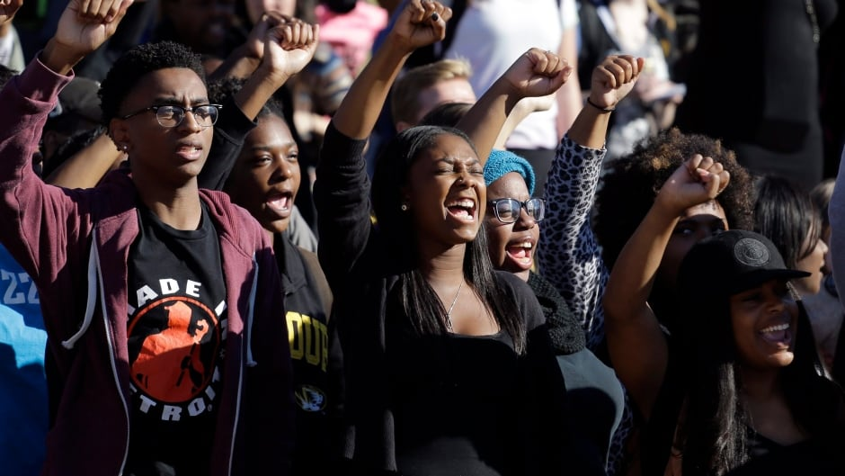 Students cheer at a protest at the University of Missouri in Columbia, Mo. Nov. 9, 2015 (AP Photo/Jeff Roberson)
