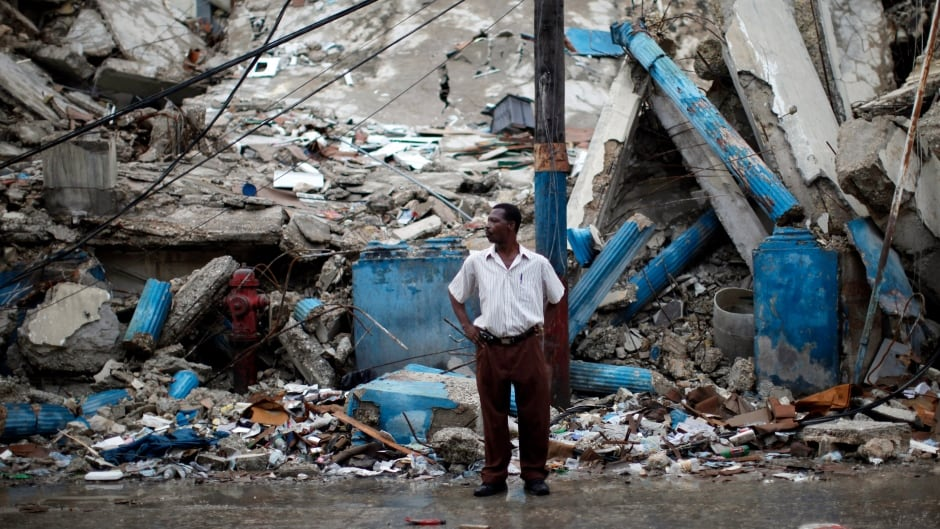 A man stands in a street in downtown Port-au-Prince February 18, 2010.