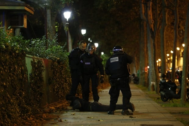 Paris ATTACKS officers detain person outside Bataclan Nov 13 2015