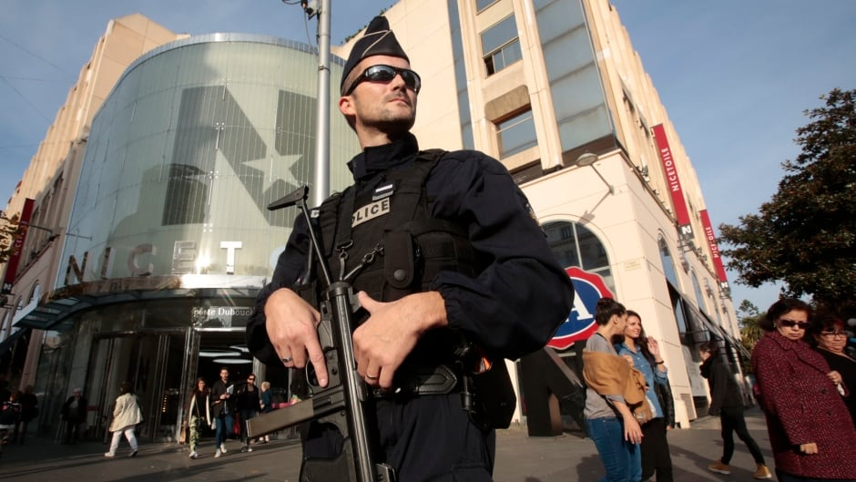 paris has had its michael s essay home the sunday  a french policeman stands guard outside a commercial centre in nice security has