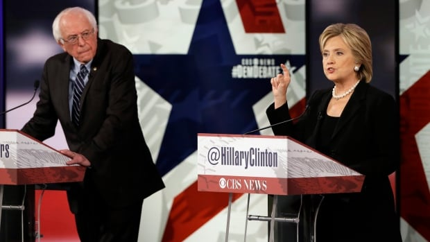 Hillary Clinton makes a point as Sen. Bernie Sanders listens during November's  Democratic presidential primary debate. The two candidates had avoided slamming each other's campaigns until Friday.