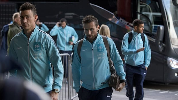 French national soccer team players, from left, Laurent Koscielny, Yohan Cabaye and Hatem Ben Arfa arrive at their hotel in London ahead of Tuesday's friendly at Wembley Stadium.