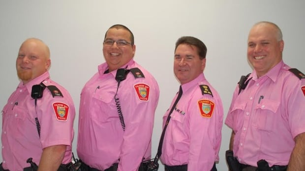 Thunder Bay police officers are putting on pink shirts this week to support an Ontario-wide anti-bullying campaign. Pictured here are  Const. Gary Cambly, Const .Bob Simon, Chief J.P. Levesque, and Const. Ben Grieve