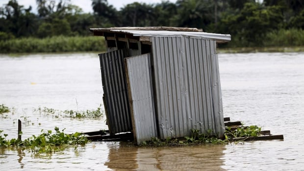 A toilet floats on the river Nun near Yenagoa, Bayelsa state in Nigeria's delta region.   More people worldwide have mobile phones than toilets.
