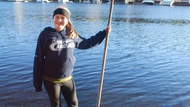 Stella Bowles collects water samples along the LaHave River.