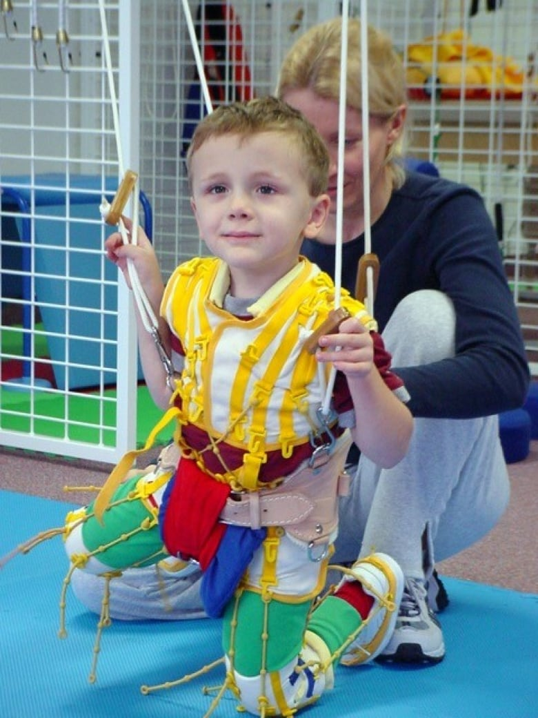 A Child Uses The Therasuit First Steps Wellness In Regina