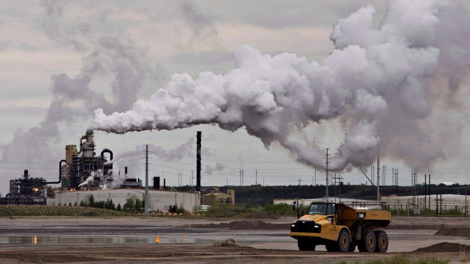 A dump truck works near the Syncrude oil sands extraction facility near the city of Fort McMurray, Alberta on Sunday June 1, 2014.