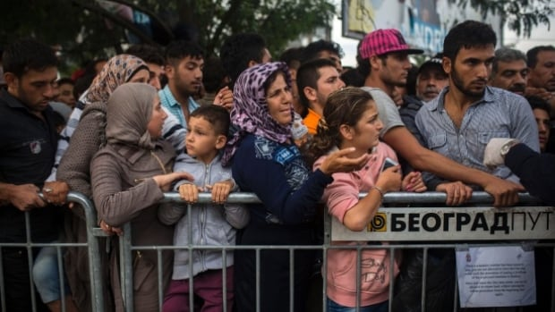 Syrian refugees waiting to be registered in Serbian town in September 2015, may be some of the more than 2,400 people to start arriving in B.C. in December.