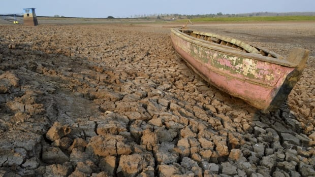 A wooden boat is seen stranded on the dry cracked riverbed of the Dawuhan Dam during drought season in Madiun, Indonesia's East Java province, October 5, 2015. Crop failures in the region are being blamed on the El Nino weather pattern, a phenomenon associated with extreme droughts, storms and floods.
