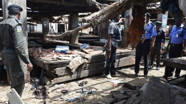 Since losing most of the territory the group seized earlier this year to the army, Boko Haram has resorted to hitting soft targets such as markets, bus stations and places of worship, as well as hit-and-run attacks on villages, mainly in Borno state. This photo is from a June attack at a market in Maiduguri, Nigeria.