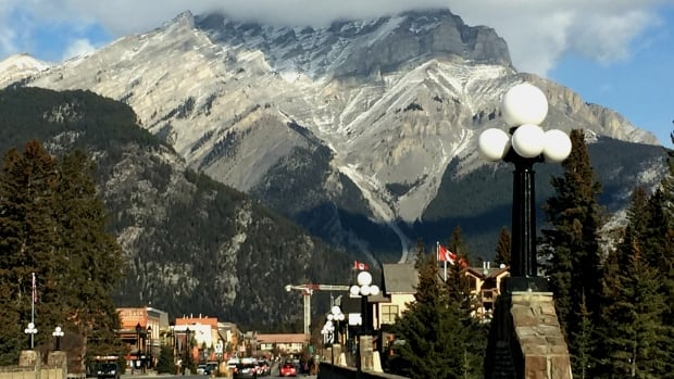 Banff is seeing a surge in tourists thanks to a low Canadian dollar, but is struggling with a lack of workers.