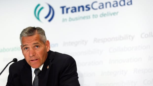 TransCanada CEO Russ Girling speaks to reporters in this file photo. The company is cutting jobs as part of structural changes in response to low oil prices, according to a spokesman.