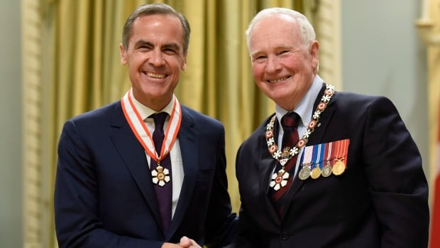 Former governor of the Bank of Canada and current Governor of the Bank of England Mark Carney is invested as an Officer of the Order of Canada by Governor General David Johnston at Rideau Hall in Ottawa, on Wednesday, Nov. 18, 2015.