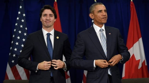 Prime Minister Justin Trudeau and U.S. President Barack Obama stand up following a bilateral meeting at the APEC summit in Manila.