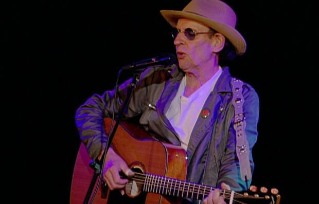 Ron Hynes performing in old photo