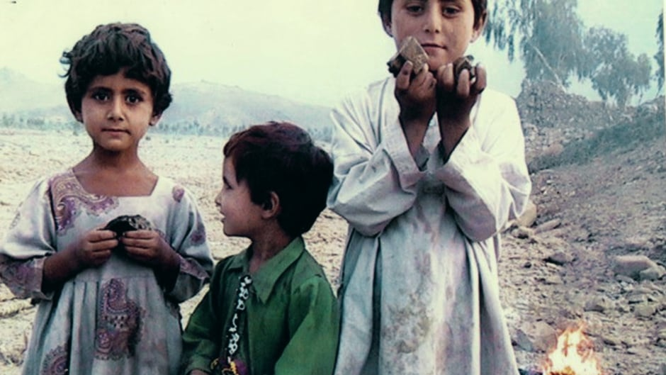 Three children stand amidst the rubble in the Dande Darpa Khel region of North Waziristan. They are holding remnants of a drone-fired missile and rubble from their neighbour's house. They don't yet understand their parents were killed in the strike. Jalaluddin Haqqani, an Afghan fighter and Taliban member who went on to found the Haqqani network, is said to have been the target.
