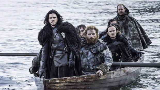 Kit Harington as Jon Snow, left, in a scene from Game of Thrones.  Bell Media has bought rights to all HBO content in Canada from Corus Entertainment.