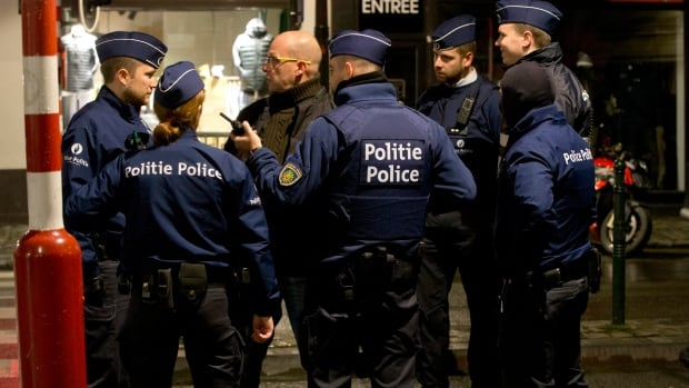 Police stand near a barricade during an operation in the centre of Brussels on Sunday.